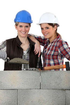 tradeswomen: Portrait of a team of bricklayers