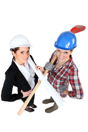 craftswoman and businesswoman posing together photo