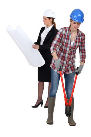 Two female construction employees Stock Photo - 13848599