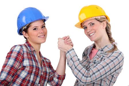 two craftswomen arm wrestling Stock Photo - 13901499