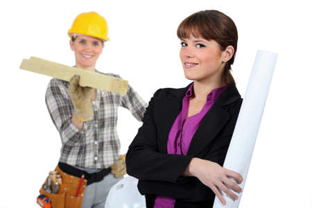 Woman carpenter and woman architect photo