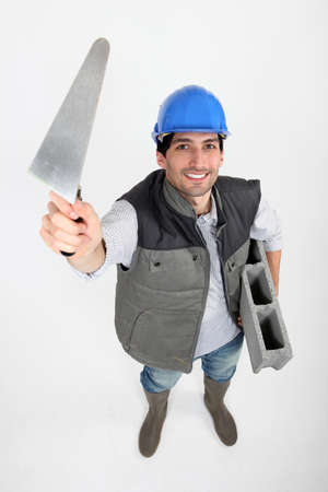 underarms: Bricklayer with trowel and cement block