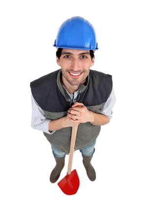 Landscape gardener stood with shovel photo