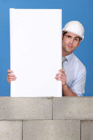 An architect presenting his blueprint. Stock Photo - 13912414