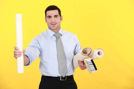 businessman holding a roller and wallpapers photo