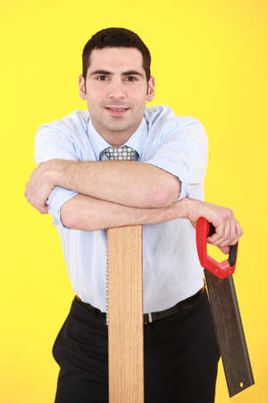 Businessman stood with hand-saw photo