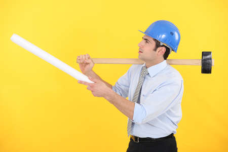 Architect with plans and a mallet Stock Photo - 13852461