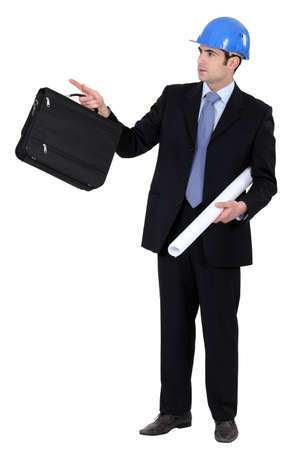 civil engineer: Engineer holding a briefcase and blueprint