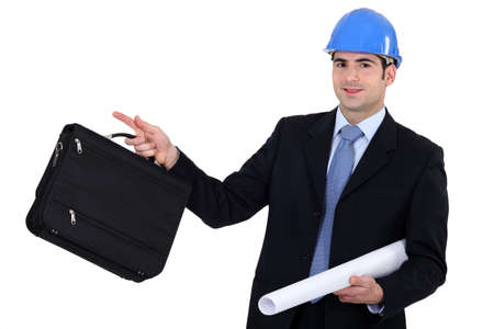 brief case: businessman going on a construction site Stock Photo