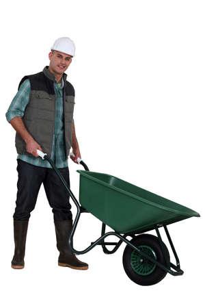 Construction worker with a wheelbarrow photo