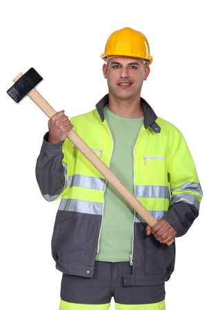 Builder holding sledge-hammer photo