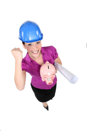 Female architect happy about her money. Stock Photo - 13825998