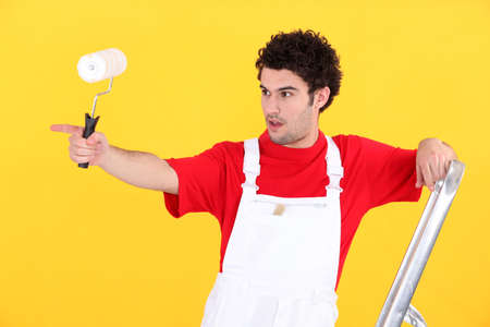 specialization: Painter pointing with finger Stock Photo