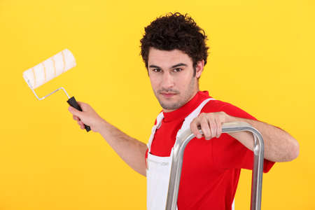 Man with a paint roller Stock Photo - 13882548