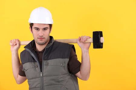sexy construction worker: Young worker with a sledgehammer