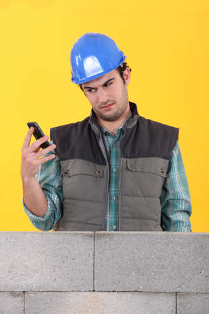 Worker readin a text message photo