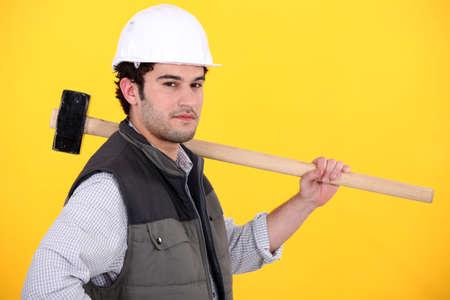 Tradesman holding a mallet Stock Photo - 13881511