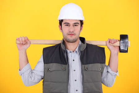 unemotional: Workman holding a mallet