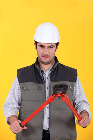 Construction worker with boltcutters photo