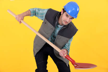 Tradesman holding a shovel photo
