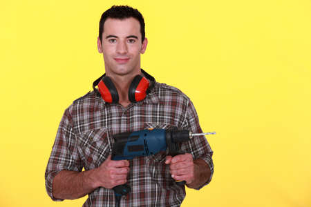 Man with soundproof earmuffs photo