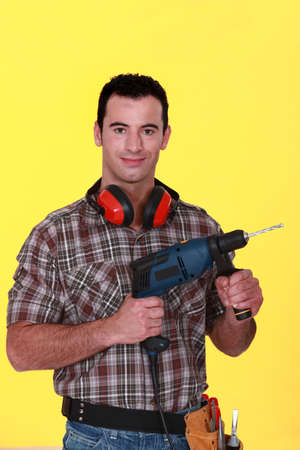 Man with drill photo
