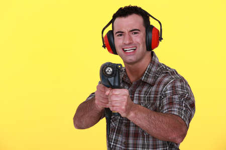 Man with a powerdrill photo