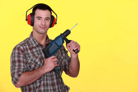 Man with a power drill photo