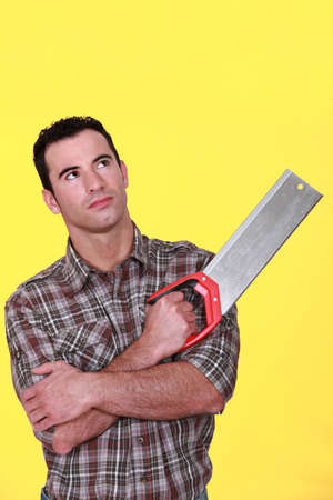 Man holding a saw Stock Photo - 13899641