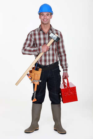 Labourer carrying tool-box photo