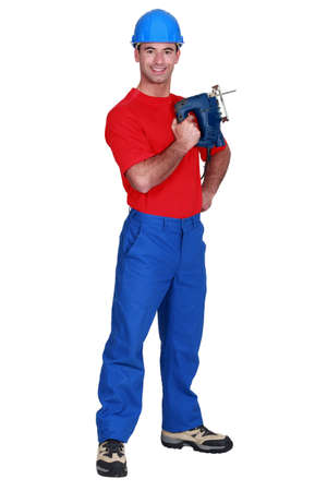 cutting machine is: Carpenter holding band-saw Stock Photo