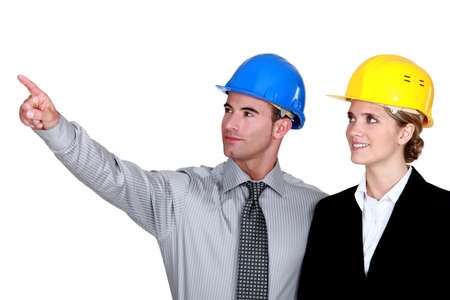 security company: businessman and businesswoman on a construction site
