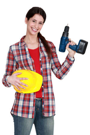 Female handywoman with drill photo