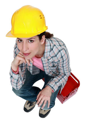 Tradeswoman sitting on toolbox photo