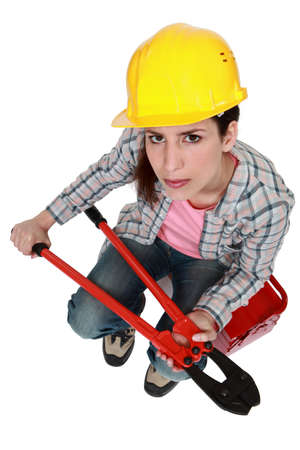 Woman with hard hat and bolt-cutters photo