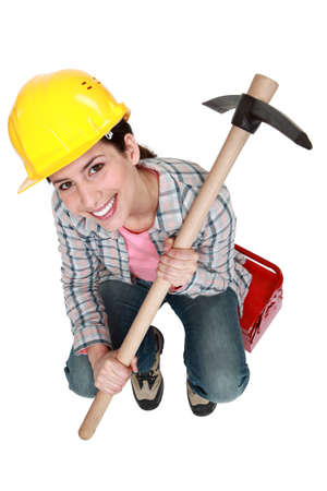 Woman holding pick-axe photo