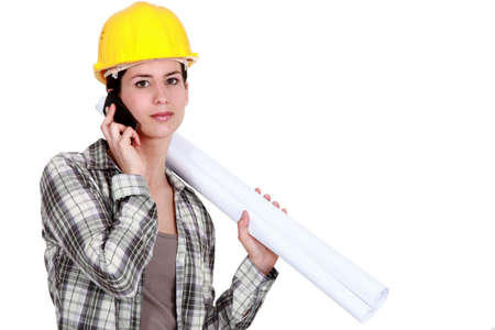 Female foreman with plans and mobile photo