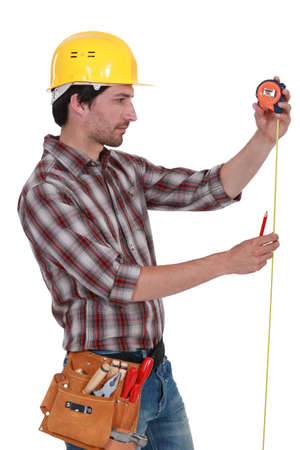 Man measuring using tape measure photo