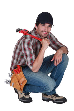Handyman with a wrench Stock Photo - 13884590