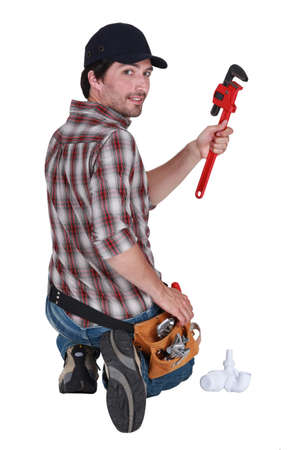 Plumber holding a pipe wrench photo