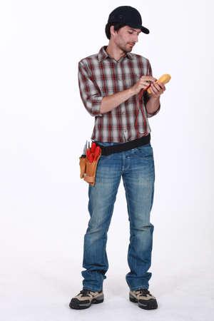Man using voltmeter photo