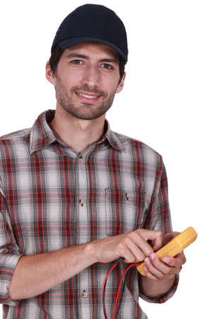 handsome electrician using tester Stock Photo - 13902201