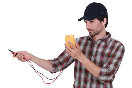 voltage: Electrician with multimeter Stock Photo