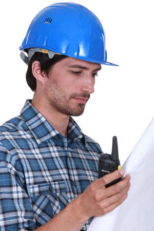 Contractor with radio receiver and plans photo