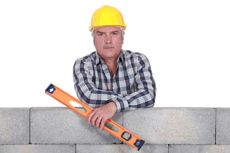 Serious builder with a spirit level photo