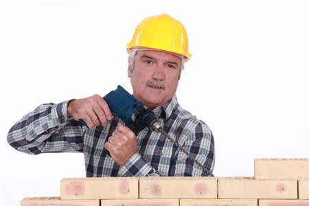 Canosa constructor de la perforación en la pared Foto de archivo - 13884588