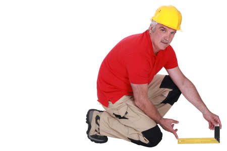 Tradesman holding a try square Stock Photo - 13829648