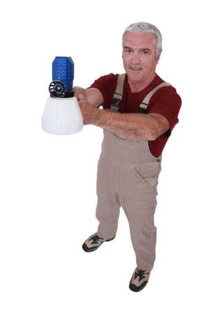 Tradesman holding a spray gun Stock Photo - 13826680