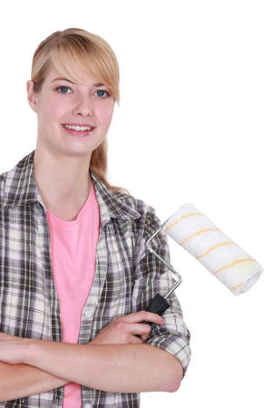 Blond woman stood with paint roller photo