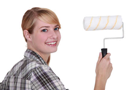 Woman with a paint roller photo